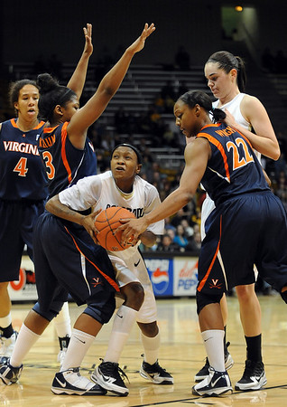 Whitney Houston of CU is boxed in by Paulisha Kellum, left, and Monica Wright, both of Virginia.<br /> <br /> Cliff Grassmick / January 2, 2010