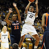 Brittany Spears of CU puts up a shot with Monica Wright of Virginia defending.<br /> <br /> Cliff Grassmick / January 2, 2010
