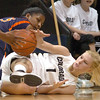 Alyssa Fressle of CU has the ball land on her during a struggle with Paulisha Kellum of Virginia on Saturday.<br /> <br /> Cliff Grassmick / January 2, 2010