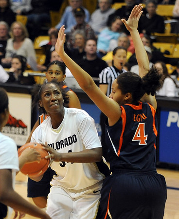 Courtney Dunn  of CU goes up on Simone Egwu of Virginia.<br /> <br /> Cliff Grassmick / January 2, 2010