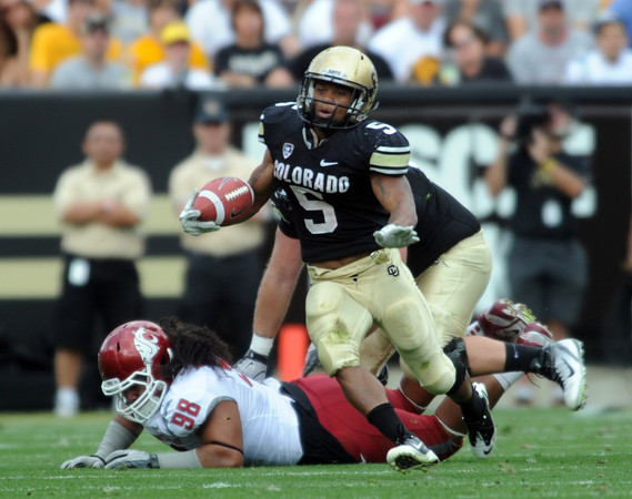 "Rodney Stewart breaks this run for a huge gain against WSU.<br /> For more photos of the game, go to  <a href=""http://www.dailycamera.com"">http://www.dailycamera.com</a><br /> Cliff Grassmick / October 1, 2011, 2011"