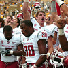 "Washington State's Tracy Clark, No. 30, cheers with the rest of his team after defeating the University of Colorado on Saturday, Oct. 1, during a football game at Folsom Field in Boulder. Washington State won the game 31-27. For more photos of the game go to  <a href=""http://www.dailycamera.com"">http://www.dailycamera.com</a><br /> Jeremy Papasso/ Camera"