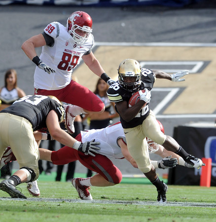 "Tony Jones of CU looks for room to run against WSU.<br /> For more photos of the game, go to  <a href=""http://www.dailycamera.com"">http://www.dailycamera.com</a><br /> Cliff Grassmick / October 1, 2011, 2011"