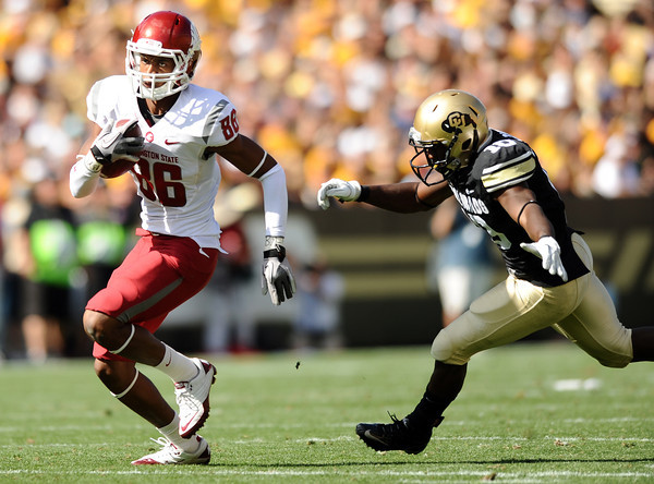 """Washington State's Marquess Wilson speeds past University of Colorado's Brian Lockridge on Saturday, Oct. 1, during a football game  at Folsom Field in Boulder. CU lost the game 31-27. For more photos of the game go to  <a href=""""http://www.dailycamera.com"""">http://www.dailycamera.com</a><br /> Jeremy Papasso/ Camera"""
