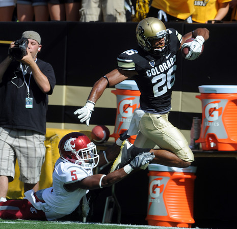"Ray Polk of CU makes a diving interception and runs in back against WSU early in the game.<br /> For more photos of the CU game, go to  <a href=""http://www.dailycamera.com"">http://www.dailycamera.com</a>.<br />  Cliff Grassmick / October 1, 2011"