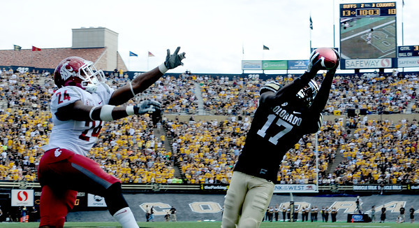 "Toney Clemons of CU catches a TD pass over Daniel Simmons of WSU.<br /> For more photos of the game, go to  <a href=""http://www.dailycamera.com"">http://www.dailycamera.com</a><br /> Cliff Grassmick / October 1, 2011, 2011"