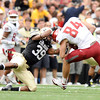 "University of Colorado's Josh Moten makes a tackle on Washington State's Jared Karstetter on Saturday, Oct. 1, during a football game against Washington State at Folsom Field in Boulder. CU lost the game 31-27. For more photos of the game go to  <a href=""http://www.dailycamera.com"">http://www.dailycamera.com</a><br /> Jeremy Papasso/ Camera"