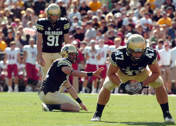 "University of Colorado kicker Will Oliver prepares to kick a field goal after a CU touchdown on Saturday, Oct. 1, during a football game against Washington State at Folsom Field in Boulder. CU lost the game 31-27. For more photos of the game go to  <a href=""http://www.dailycamera.com"">http://www.dailycamera.com</a><br /> Jeremy Papasso/ Camera"