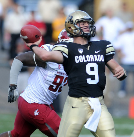 "Tyler Hansen looks to pass against Washington State.<br /> For more photos of the CU game, go to  <a href=""http://www.dailycamera.com"">http://www.dailycamera.com</a>.<br />  Cliff Grassmick / October 1, 2011"
