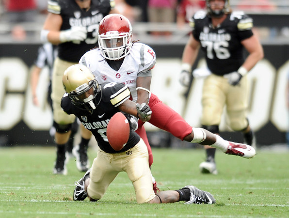 """University of Colorado's Paul Richardson fumbles the ball late in the fourth quarter after being tackled by Damante Horton on Saturday, Oct. 1, during a football game against Washington State at Folsom Field in Boulder. CU lost the game 31-27. For more photos of the game go to  <a href=""""http://www.dailycamera.com"""">http://www.dailycamera.com</a><br /> Jeremy Papasso/ Camera"""
