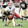 "University of Colorado's Paul Richardson fumbles the ball late in the fourth quarter after being tackled by Damante Horton on Saturday, Oct. 1, during a football game against Washington State at Folsom Field in Boulder. CU lost the game 31-27. For more photos of the game go to  <a href=""http://www.dailycamera.com"">http://www.dailycamera.com</a><br /> Jeremy Papasso/ Camera"