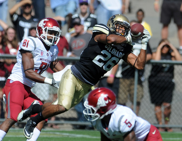"Ray Polk of CU makes a diving interception against WSU early in the game.<br /> For more photos of the CU game, go to  <a href=""http://www.dailycamera.com"">http://www.dailycamera.com</a>.<br />  Cliff Grassmick / October 1, 2011"