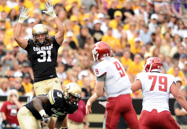 "University of Colorado's Jon Major tries to block a pass from Washington State quarterback Marshall Lobbestael on Saturday, Oct. 1, during a football game against Washington State at Folsom Field in Boulder. CU lost the game 31-27. For more photos of the game go to  <a href=""http://www.dailycamera.com"">http://www.dailycamera.com</a><br /> Jeremy Papasso/ Camera"
