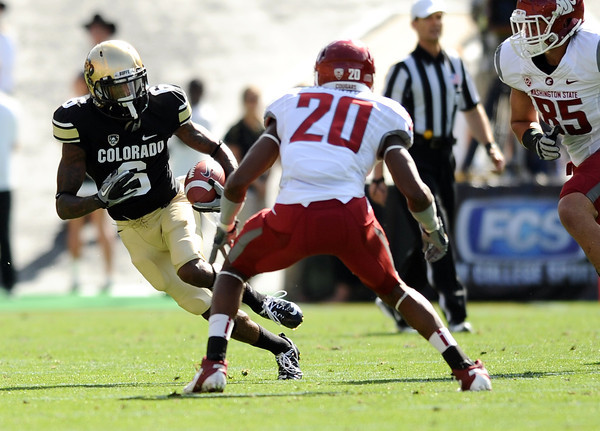 "University of Colorado's Paul Richardson jukes Washington State's Deone Bucannon after making a catch on Saturday, Oct. 1, during a football game against Washington State at Folsom Field in Boulder. CU lost the game 31-27. For more photos of the game go to  <a href=""http://www.dailycamera.com"">http://www.dailycamera.com</a><br /> Jeremy Papasso/ Camera"