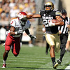 "University of Colorado's Ray Polk tries to avoid a tackle by Washington's Rickey Galvin after making an interception in the first quarter on Saturday, Oct. 1, during a football game against Washington State at Folsom Field in Boulder. For more photos of the game go to  <a href=""http://www.dailycamera.com"">http://www.dailycamera.com</a><br /> Jeremy Papasso/ Camera"