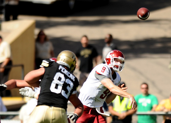 "Washington State quarterback Marshall Lobbestael throws a pass on Saturday, Oct. 1, during a football game against the University of Colorado at Folsom Field in Boulder. Washington State won the game 31-27. For more photos of the game go to  <a href=""http://www.dailycamera.com"">http://www.dailycamera.com</a><br /> Jeremy Papasso/ Camera"
