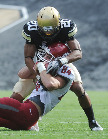"""Greg Henderson of CU wraps ups Jared Karstetter of WSU.<br /> For more photos of the game, go to  <a href=""""http://www.dailycamera.com"""">http://www.dailycamera.com</a><br /> Cliff Grassmick / October 1, 2011, 2011"""