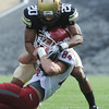 "Greg Henderson of CU wraps ups Jared Karstetter of WSU.<br /> For more photos of the game, go to  <a href=""http://www.dailycamera.com"">http://www.dailycamera.com</a><br /> Cliff Grassmick / October 1, 2011, 2011"