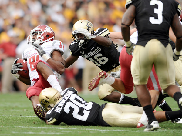 "University of Colorado's Greg Henderson, No. 20, and Makiri Pugh make a tackle on Washington State's Isiah Barton on Saturday, Oct. 1, during a football game against Washington State at Folsom Field in Boulder. CU lost the game 31-27. For more photos of the game go to  <a href=""http://www.dailycamera.com"">http://www.dailycamera.com</a><br /> Jeremy Papasso/ Camera"