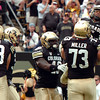 "University of Colorado's Ryan Miller holds Rodney Stewart after he scored a touchdown on Saturday, Oct. 1, during a football game against Washington State at Folsom Field in Boulder. CU lost the game 31-27. For more photos of the game go to  <a href=""http://www.dailycamera.com"">http://www.dailycamera.com</a><br /> Jeremy Papasso/ Camera"