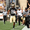 "University of Colorado's Ray Polk runs back an interception for big yardage on Saturday, Oct. 1, during a football game against Washington State at Folsom Field in Boulder. CU lost the game 31-27. For more photos of the game go to  <a href=""http://www.dailycamera.com"">http://www.dailycamera.com</a><br /> Jeremy Papasso/ Camera"
