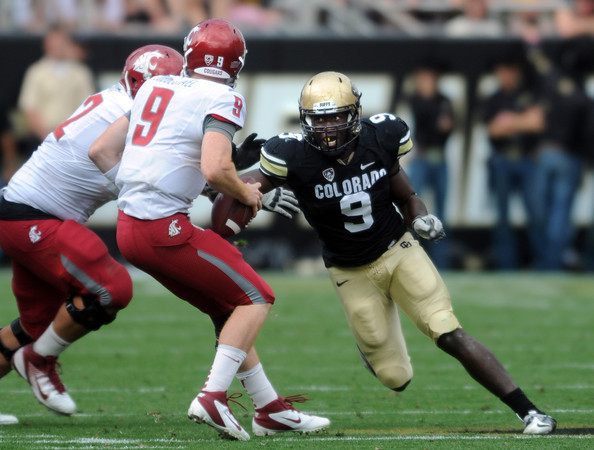 """Chidera Uzo-Diribe chases down  WSU quarterback,   Marshall Lobbestael of WSU.<br /> For more photos of the game, go to  <a href=""""http://www.dailycamera.com"""">http://www.dailycamera.com</a><br /> Cliff Grassmick / October 1, 2011, 2011"""