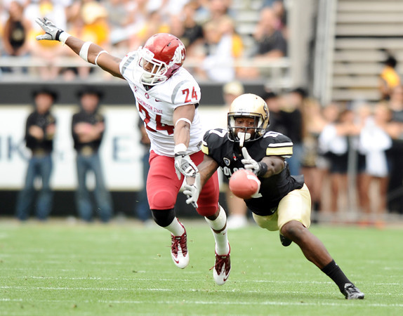 "University of Colorado's Toney Clemons misses a pass because of pass interference by Washington State's Daniel Simmons on Saturday, Oct. 1, during a football game against Washington State at Folsom Field in Boulder. CU lost the game 31-27. For more photos of the game go to  <a href=""http://www.dailycamera.com"">http://www.dailycamera.com</a><br /> Jeremy Papasso/ Camera"