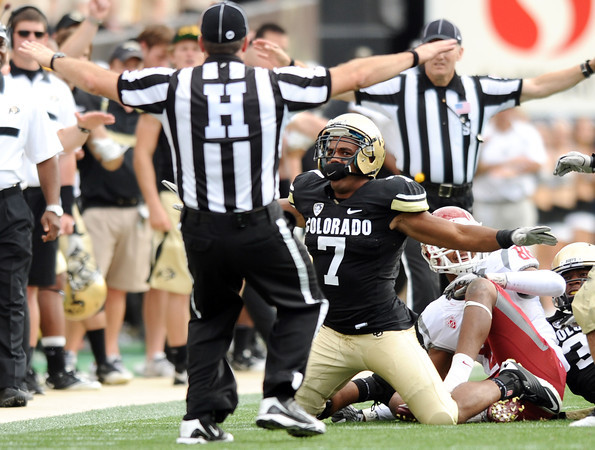 "University of Colorado's Anthony Perkins shows his emotion while agreeing with the referee's call on Saturday, Oct. 1, during a football game against Washington State at Folsom Field in Boulder. CU lost the game 31-27. For more photos of the game go to  <a href=""http://www.dailycamera.com"">http://www.dailycamera.com</a><br /> Jeremy Papasso/ Camera"