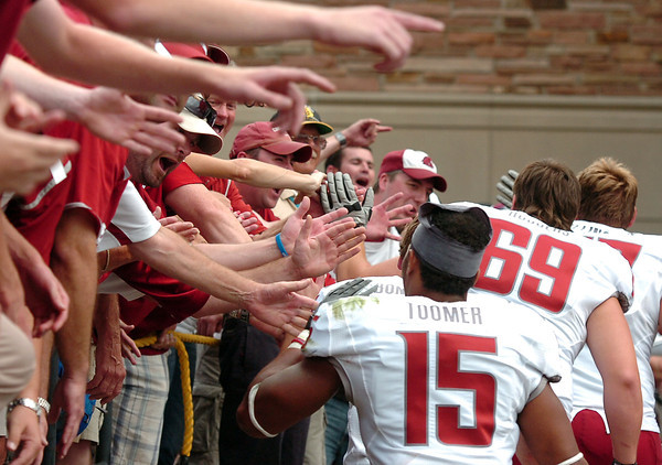 """Washington State fans congratulate the team after defeating the University of Colorado on Saturday, Oct. 1, during a football game against Washington State at Folsom Field in Boulder. Washington State won the game 31-27. For more photos of the game go to  <a href=""""http://www.dailycamera.com"""">http://www.dailycamera.com</a><br /> Jeremy Papasso/ Camera"""