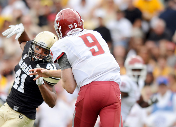 "University of Colorado's Terrel Smith, left, tries to make a sack on Washington State quarterback Marshall Lobbestael on Saturday, Oct. 1, during a football game against Washington State at Folsom Field in Boulder. CU lost the game 31-27. For more photos of the game go to  <a href=""http://www.dailycamera.com"">http://www.dailycamera.com</a><br /> Jeremy Papasso/ Camera"