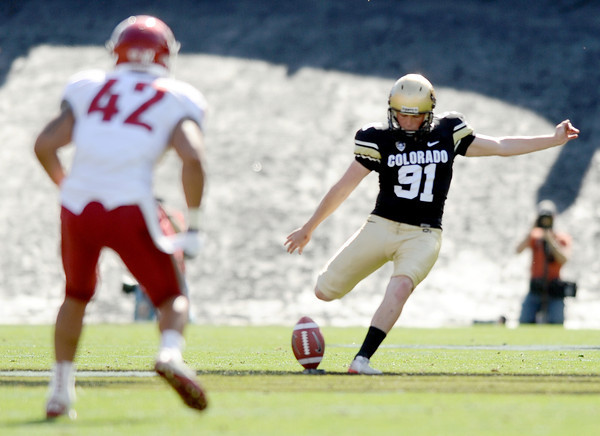 "University of Colorado kicker Will Oliver kicks off after a CU touchdown on Saturday, Oct. 1, during a football game against Washington State at Folsom Field in Boulder. CU lost the game 31-27. For more photos of the game go to  <a href=""http://www.dailycamera.com"">http://www.dailycamera.com</a><br /> Jeremy Papasso/ Camera"