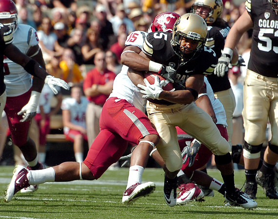 "University of Colorado's Rodney Stewart gets tackled by Tyree Toomer on Saturday, Oct. 1, during a football game against Washington State at Folsom Field in Boulder. CU lost the game 31-27. For more photos of the game go to  <a href=""http://www.dailycamera.com"">http://www.dailycamera.com</a><br /> Jeremy Papasso/ Camera"