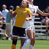 "Carmen Blume, left, of Wyoming, and Kelly Ross of Colorado, go up to connect on the header.<br /> For more  soccer photos, go to  <a href=""http://www.dailycamera.com"">http://www.dailycamera.com</a>.<br /> Cliff Grassmick / August 22, 2010"