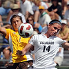 "Shalayne Janis, left, of Wyoming, and Taryn Vittacca of CU, collide while going for the ball.<br /> For more  soccer photos, go to  <a href=""http://www.dailycamera.com"">http://www.dailycamera.com</a>.<br /> Cliff Grassmick / August 22, 2010"