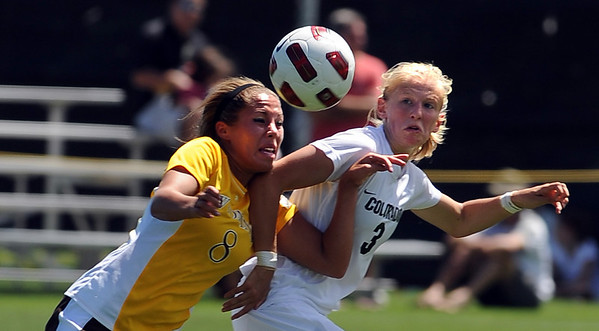 "Carmen Blume, left, of Wyoming, and Alex Dohm, of Colorado, battle for position on Sunday.<br /> For more  soccer photos, go to  <a href=""http://www.dailycamera.com"">http://www.dailycamera.com</a>.<br /> Cliff Grassmick / August 22, 2010"