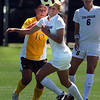 """Nahiomy Ortiz (10) of Wyoming, and Anne Stuller of Colorado, track the ball on Sunday.<br /> For more  soccer photos, go to  <a href=""""http://www.dailycamera.com"""">http://www.dailycamera.com</a>.<br /> Cliff Grassmick / August 22, 2010"""