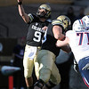 "Tyler Hansen of CU unloads a pass against Arizona.<br /> For more photos of the Buffs, go to  <a href=""http://www.dailycamera.com"">http://www.dailycamera.com</a><br /> Cliff Grassmick / November 12, 2011"