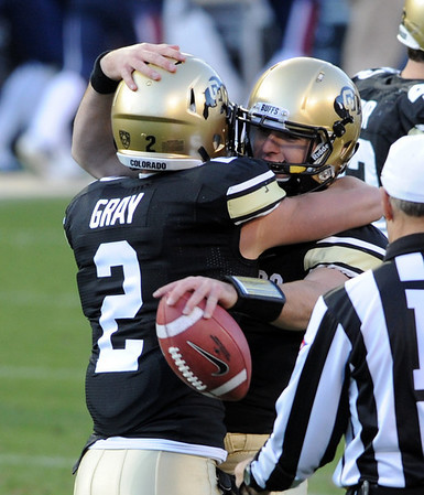 "Tyler Hansen, right, has a hug for Logan Gray after the final whistle. They both played theri last game at Folsom Field.<br /> For more photos of the Buffs, go to  <a href=""http://www.dailycamera.com"">http://www.dailycamera.com</a><br /> Cliff Grassmick / November 12, 2011"