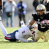 "University of Colorado's Rodney Stewart is tackled by Arizona's Marquis Flowers during a game against the University of Arizona on Saturday, Nov. 12, at Folsom Field on the CU campus in Boulder. For more photos of the game go to  <a href=""http://www.dailycamera.com"">http://www.dailycamera.com</a><br /> Jeremy Papasso/ Camera"