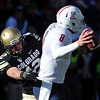 "Patrick Mahnke of CU pressures Nick Foles of Arizona.<br /> For more photos of the Buffs, go to  <a href=""http://www.dailycamera.com"">http://www.dailycamera.com</a><br /> Cliff Grassmick / November 12, 2011"