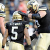 "University of Colorado's Rodney Stewart is congratulated by his teammate and fellow senior Ryan Miller after a fourth quarter touchdown during a game against the University of Arizona on Saturday, Nov. 12, at Folsom Field on the CU campus in Boulder. CU won the game 48-29. For more photos of the game go to  <a href=""http://www.dailycamera.com"">http://www.dailycamera.com</a><br /> Jeremy Papasso/ Camera"