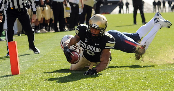 "Rodney Stewart of CU stretches out for his first touchdown against Arizona on Saturday.<br /> For more photos of the Buffs, go to  <a href=""http://www.dailycamera.com"">http://www.dailycamera.com</a><br /> Cliff Grassmick / November 12, 2011"