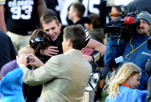 "Tyler Hansen of CU has hugs for everyone after the CU win over Arizona.<br /> For more photos of the Buffs, go to  <a href=""http://www.dailycamera.com"">http://www.dailycamera.com</a><br /> Cliff Grassmick / November 12, 2011"