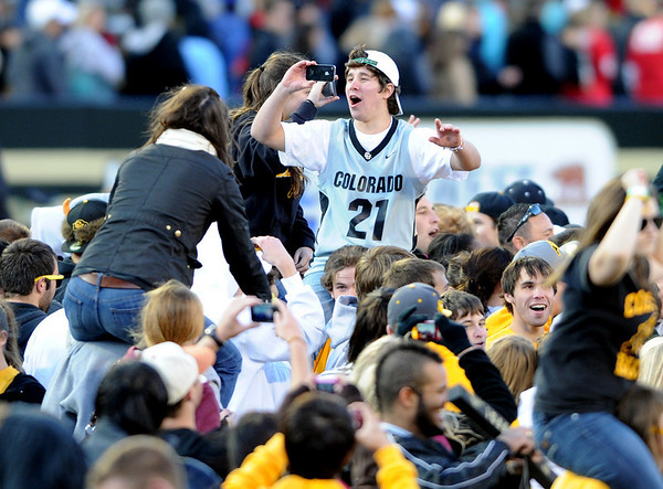 """University of Colorado football fans come on to the field after the Buffaloes win over Arizona on Saturday.<br /> For more photos of the Buffs, go to  <a href=""""http://www.dailycamera.com"""">http://www.dailycamera.com</a><br /> Cliff Grassmick / November 12, 2011"""