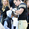 "Tyler Hansen signs the hoody of a boy after the big win over Arizona.<br /> For more photos of the Buffs, go to  <a href=""http://www.dailycamera.com"">http://www.dailycamera.com</a><br /> Cliff Grassmick / November 12, 2011"
