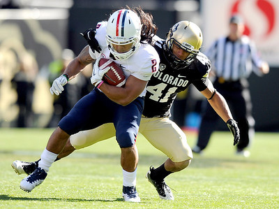 University of Colorado's Terrel Smith makes a tackle on Arizona's Keola Antolin during a game against the University of Arizona on Saturday, Nov. 12, at Folsom Field on the CU campus in Boulder. For more photos of the game go to www.dailycamera.com Jeremy Papasso/ Camera
