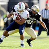 "University of Colorado's Terrel Smith makes a tackle on Arizona's Keola Antolin during a game against the University of Arizona on Saturday, Nov. 12, at Folsom Field on the CU campus in Boulder. For more photos of the game go to  <a href=""http://www.dailycamera.com"">http://www.dailycamera.com</a><br /> Jeremy Papasso/ Camera"
