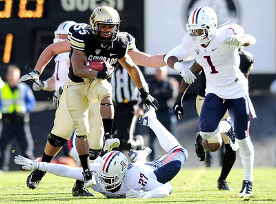 University of Colorado's Rodney Stewart leaps over Arizona's Tra' Mayne Bondurant while rushing the ball during a game against the University of Arizona on Saturday, Nov. 12, at Folsom Field on the CU campus in Boulder. For more photos of the game go to www.dailycamera.com Jeremy Papasso/ Camera