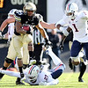 "University of Colorado's Rodney Stewart leaps over Arizona's Tra' Mayne Bondurant while rushing the ball during a game against the University of Arizona on Saturday, Nov. 12, at Folsom Field on the CU campus in Boulder. For more photos of the game go to  <a href=""http://www.dailycamera.com"">http://www.dailycamera.com</a><br /> Jeremy Papasso/ Camera"