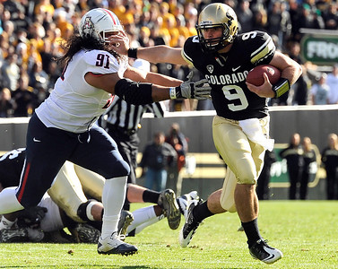 University of Colorado's Tyler Hansen stiff arms Arizona's Sione Tuihalamaka while rushing the ball during a game against the University of Arizona on Saturday, Nov. 12, at Folsom Field on the CU campus in Boulder. CU won the game 48-29. For more photos of the game go to www.dailycamera.com Jeremy Papasso/ Camera